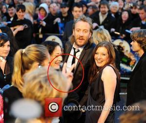 Emma Thompson gives Rhys Ifans the 2 fingers. 'Nanny McPhee And The Big Bang' World film premiere held at the...