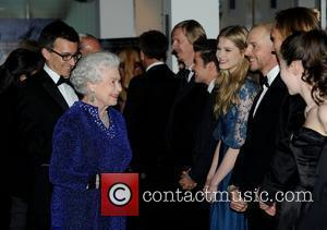 Queen Elizabeth ll meets Laura Brent, Simon Pegg, William Moseley and Anna Popplewell at the Royal Premiere of 'The Chronicles...