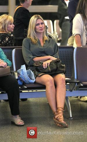 Natasha Henstridge waits for a passenger to arrive at LAX. Los Angeles, California - 23.09.10