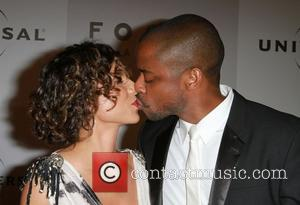 Dule Hill and Guest NBC Universal's 68th Annual Golden Globes After Party held at The Beverly Hilton hotel Beverly Hills,...