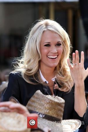 CARRIE UNDERWOOD shows off her wedding ring