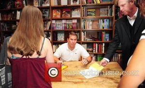 Author Nicholas Sparks  signs copies of his new book 'Safe Haven', and greets fans at Books and Books store...