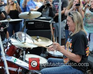 Nicko McBrain of Iron Maiden  performs outside his restaurant 'Rock and Roll Ribs' in Coral Springs.  Florida, USA...