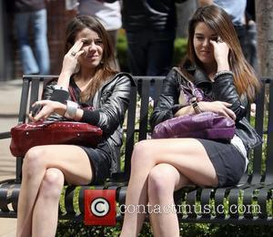 Nikita and Jade Ramsey  sitting on a bench chatting while out at the Grove in Hollywood. Los Angeles, California...