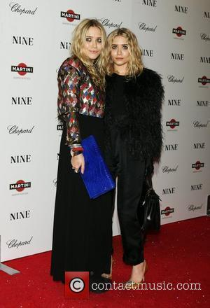 Mary-Kate Olsen and Ashley Olsen New York premiere of 'Nine' sponsored by Chopard at the Ziegfeld Theatre New York City,...