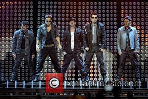 Danny Wood, Joey McIntyre, Donnie Wahlberg, Jordan Knight, Jonathan Knight New Kids on The Block performing live on stage during...