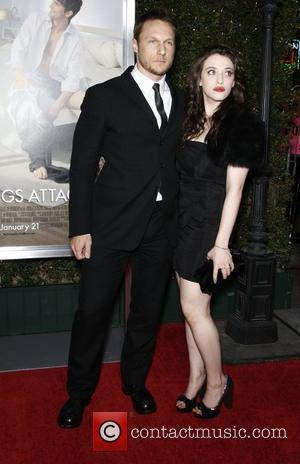Kat Dennings and guest  Los Angeles Premiere of No Strings Attached held at the Regency Village Theatre Los Angeles,...