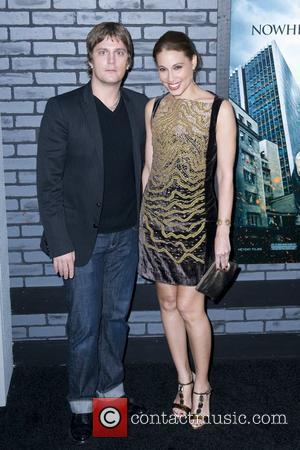 Rob Thomas and Marisol Maldonado  The premiere of 'Harry Potter and the Deathly Hallows - Part 1' at Alice...