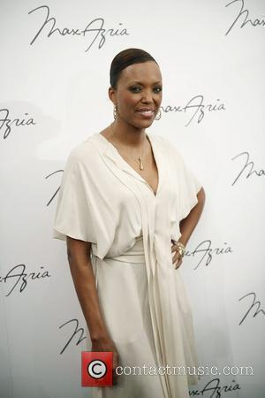 Aisha Tyler and Max Azria
