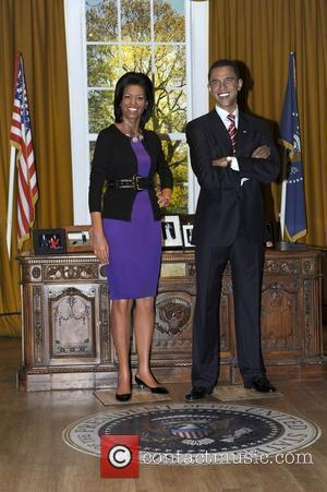 Michelle Obama and Barack Obama (Waxwork) A waxwork of Michelle Obama is unveiled at Madame Tussauds next to a waxwork...