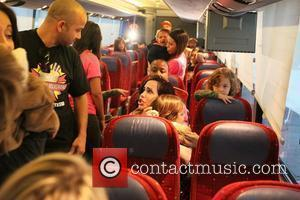 Octomom aka Nadina Suleman is taken from her home via a tour bus on her way to Millions of Milkshakes...