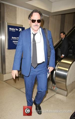 Oliver Stone is seen arriving at LAX airport from New York. Los Angeles, California - 27.07.10
