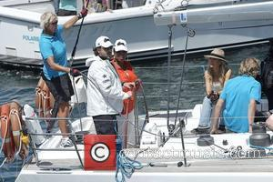 Oprah Winfrey skippers a yacht with Russell Crowe on Sydney Harbour in a regatta raced by Oprah audience members. They...