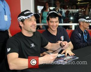 Patrick Dempsey  signs autographs prior to the Rolex 24 hours of Daytona road race at Daytona International Speedway...