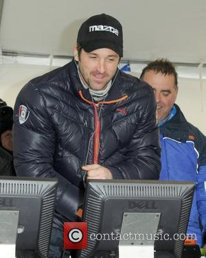 Patrick Dempsey  watches Dempsey Racings No. 40 Mazda RX8 complete the Rolex 24 Hours of Daytona at Daytona International...