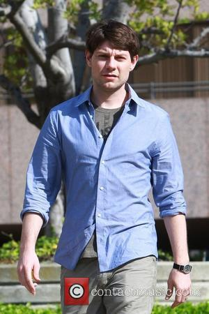 Patrick Fugit, 27, walks back to his trailer during a break in filming his new TV show 'Wright vs. Wrong'...
