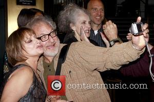 Patti LuPone and Timothy Jerome taking a photo Book Party for 'Patti LuPone: A Memoir' held at the Vivian Beaumont...