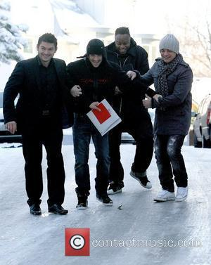 Peter Andre and his entourage try to navigate his icy driveway as he leaves his house ahead of his performance...