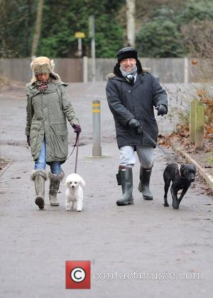 Peter Hook taking his dogs for a walk in the park. Alderley Edge, England - 02.01.11