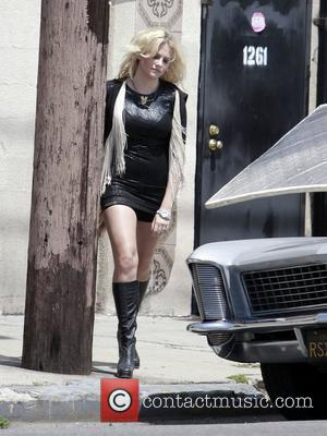 British popstar Pixie Lott films her new music video in Downtown LA with a classic car and struts down a...