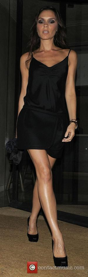 Victoria Beckham is seen arriving at Gordon Ramsay's restaurant Maze in a sexy black cocktail dress. London, England - 04.09.10