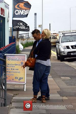 Samuel Preston has a cigarette with a friend outside Woodies Longboard Diner  Hove, England - 15.09.10