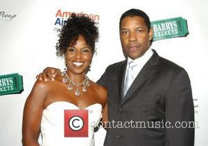 Denzel Washington and Paulette Washington