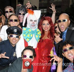 Rachael Ray and her husband John Cusimano dress as Jessica Rabbit and Roger Rabbit and pose during a taping of...