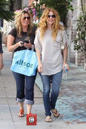 Rachelle Lefevre of Twilight wearing tight jeans and flip flops out shopping with friends on Robertson Boulevard West Hollywood, California...