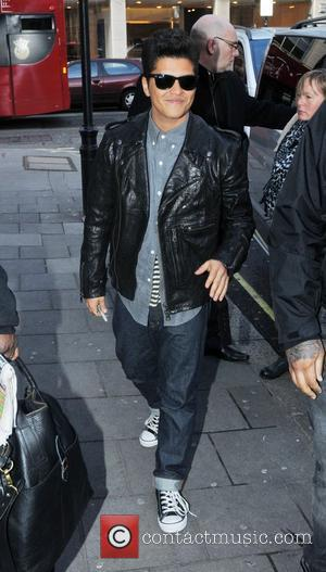 Bruno Mars arriving at the BBC Radio One studios London, England - 19.01.11