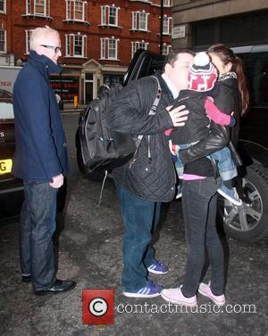 Peter Kay kisses Chris Evan's son Noah outside the BBC Radio 2 studios London, England - 10.12.10
