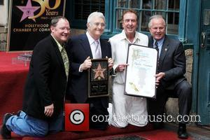 John Lasseter, Randy Newman and Eric Idle  Singer and composer Randy Newman is honoured with the 2411th star on...