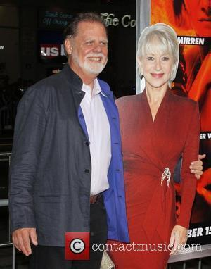 Taylor Hackford with a cardboard cutout of Helen Mirren Special screening of Summit Entertainment's 'RED'  held at the Grauman's...