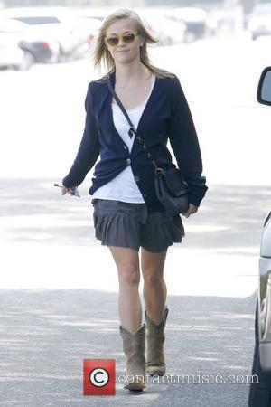 Reese Witherspoon leaving Neil George salon in Beverly Hills wearing cowboy boots Los Angeles, California - 06.08.10