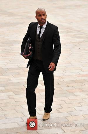 Ricky Whittle arriving at Liverpool Crown Court to stand trial for dangerous driving after he allegedly struck photographer Steve Farrell...