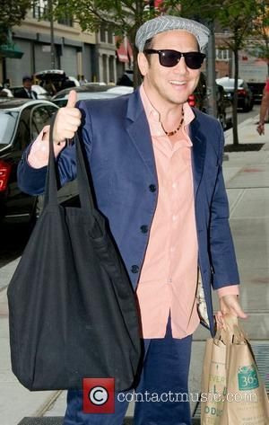 Rob Schneider  arrives at his Manhattan hotel, carrying a large black bag New York City, USA - 10.08.10