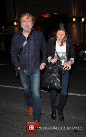 Robert Plant and his PA leaving Morton's Steak House. Toronto, Canada - 16.09.10.