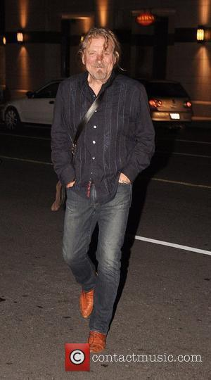 Robert Plant is seen leaving Morton's Steak House and heads back to his hotel Toronto, Canada - 16.09.10