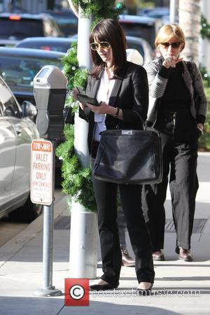 Robin Tunney pays a parking meter in Beverly Hills Los Angeles, California - 16.12.09