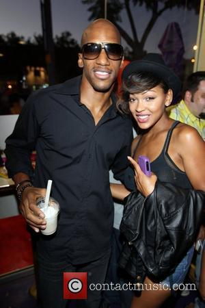 Meagan Good and guest Romeo celebrates his 21st birthday by creating a custom shake at 'Millions of Milkshakes' in West...