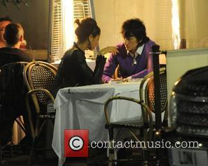 Ronnie Wood, His Girlfriend Ana Araujo Pop Outside For A Cigarette Break and During A Meal Together At A Restaurant In Mayfair.