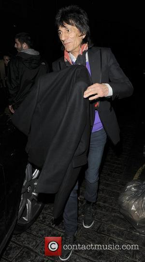 Ronnie Wood, His Girlfriend Ana Araujo Leaving A Restaurant In Mayfair and Having Enjoyed Dinner There Together