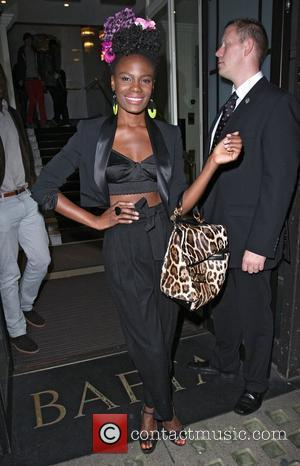 Shingai Shoniwa leaves a special screening of the film 'Runaway' at Bafta Piccadilly London, England - 07.10.10