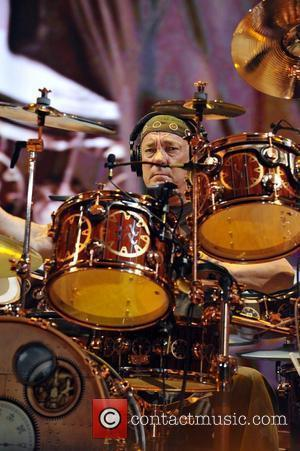 Neil Peart Canadian rock band Rush performs live at the Cruzan Amphitheater West Palm Beach, Florida - 02.10.10