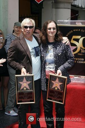 Alex Lifeson and Geddy Lee of Rush Rush is honoured with the 2,412th Star on the Hollywood Walk of Fame...