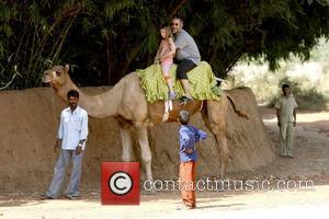 David Baddiel and daughter Dolly Loveday ride a camel Russell Brand visits a safari reserve in Ranthambhore with his wedding...