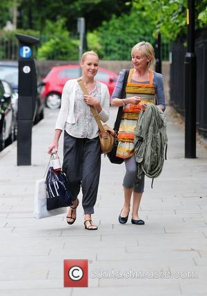 Sally Whittaker aka Sally Dynevor returning to work at Granada Studios after shopping with a friend. Sally's hair appears to...