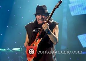 Carlos Santana performing at the Manchester Evening News Arena Manchester, England - 02.10.10