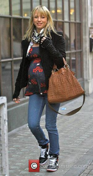 Sara Cox The heavily pregnant radio presenter, expecting her third child, arriving at the Radio One studios. London, England -...