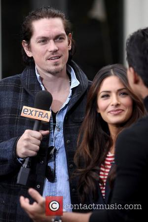 Steve Howey and Sarah Shahi filming an interview for entertainment television news programme 'Extra' at The Grove in Hollywood Los...